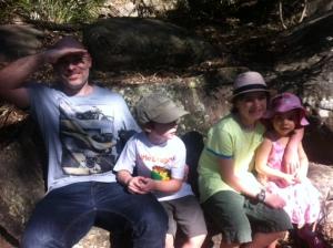 family on stone seat